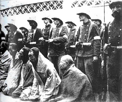 Indo Europeans standing behind Chinese to be beheaded.jpg