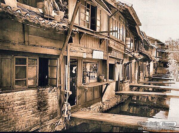 Canal in front of shops Lijiang 1995..jpg