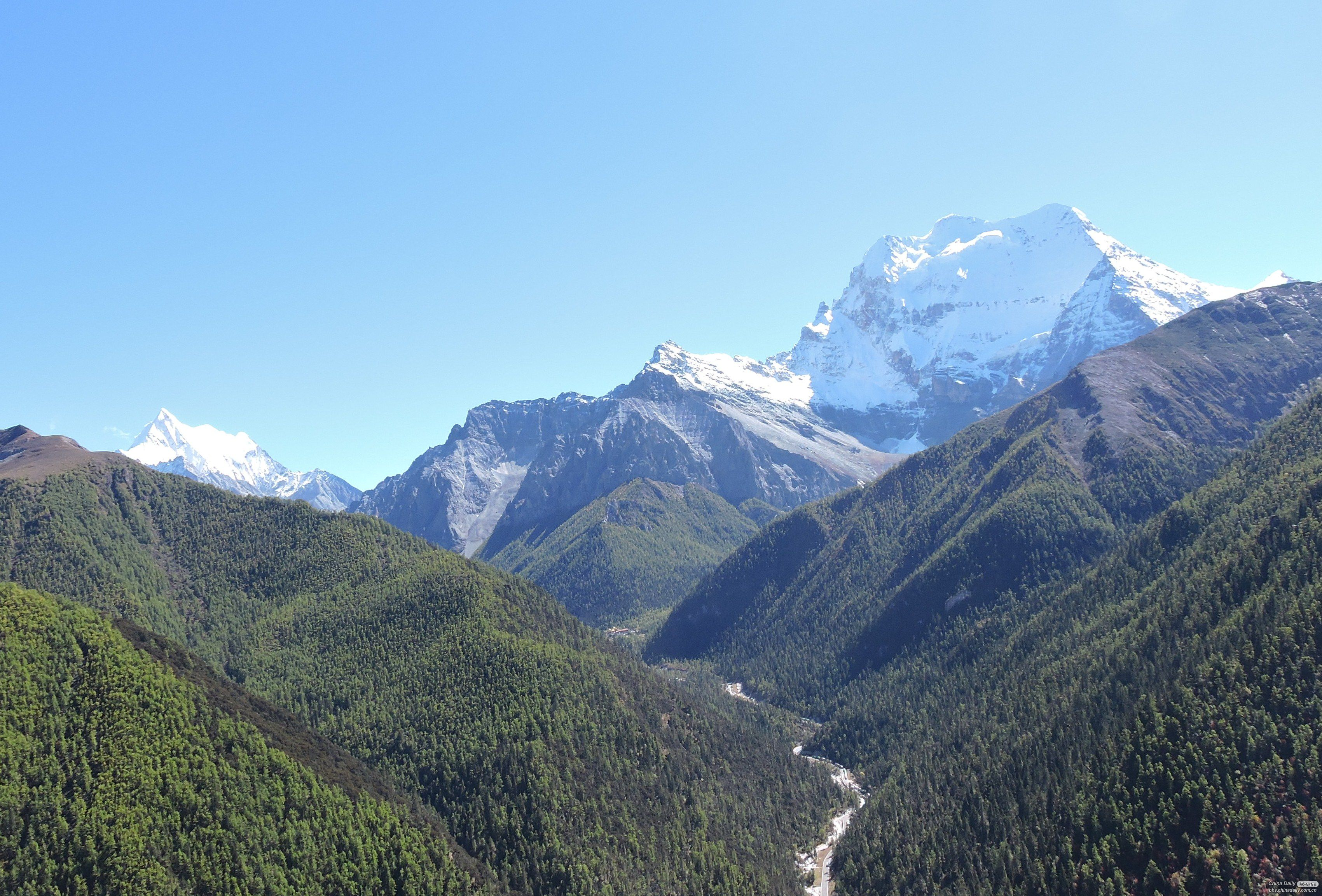 Mt. Chana Dorjie and Chenresig and a valley with lush vegetation even above 4,000m altitude
