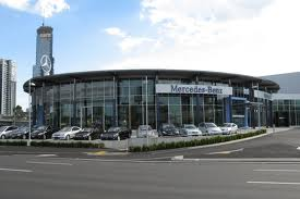 Car showroom employs a well paid lot.jpg
